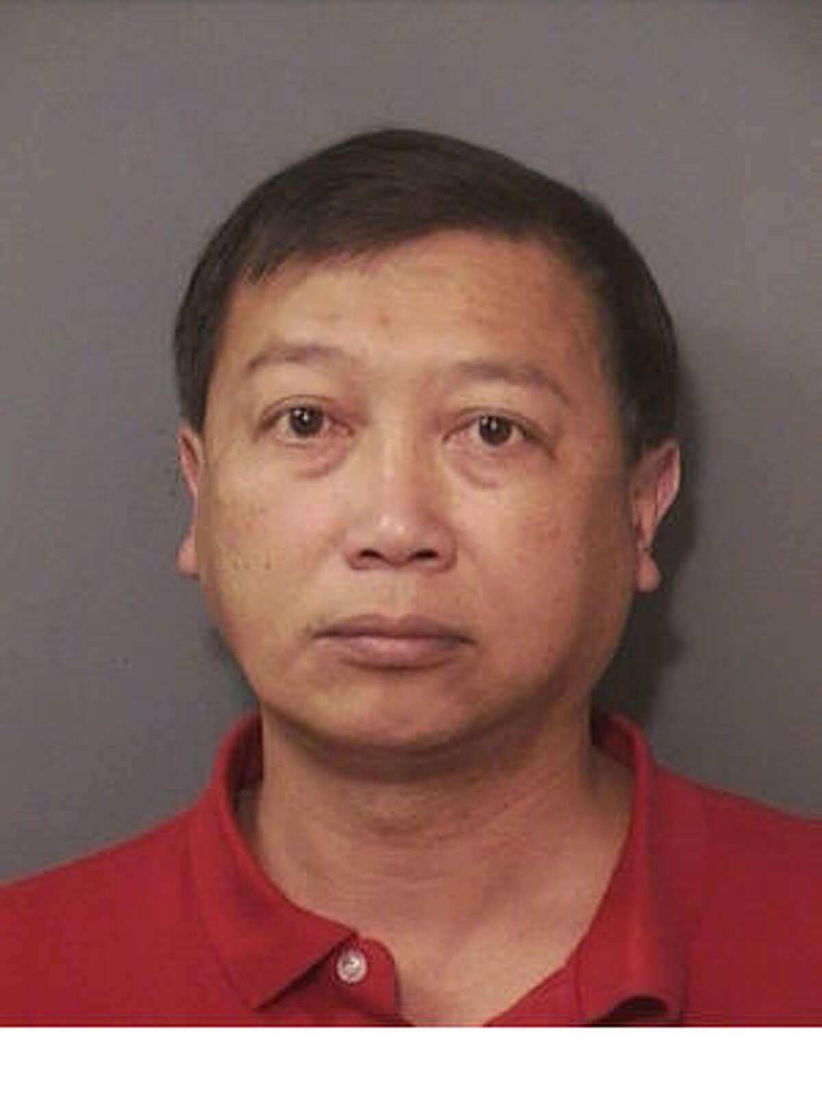 Deputy Wilbert Jue, 52, was fired from his job in Precinct 1 Constable Jack Abercia's office.