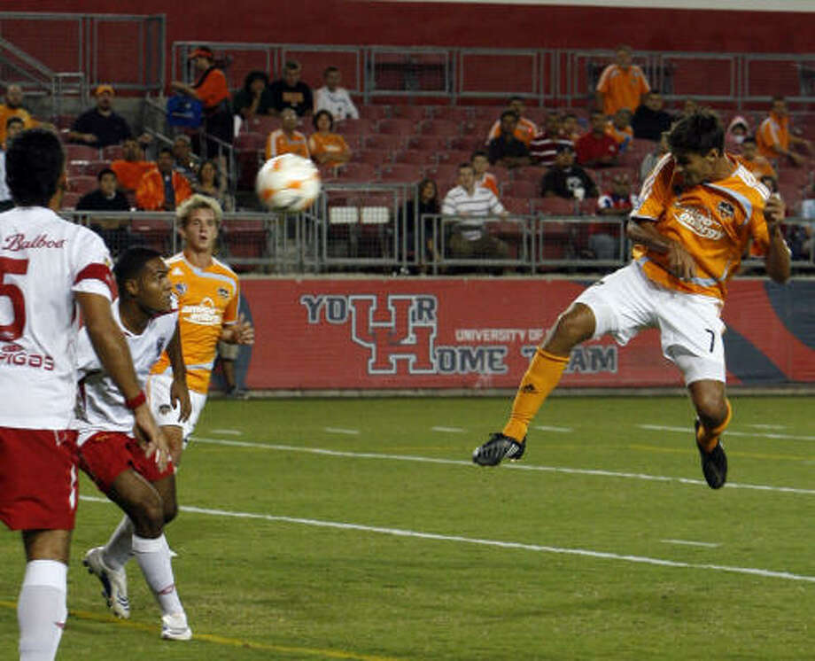 The Dynamo's Chris Wondolowski scores the only goal of the first half against San Francisco FC. Photo: Johnny Hanson, Chronicle