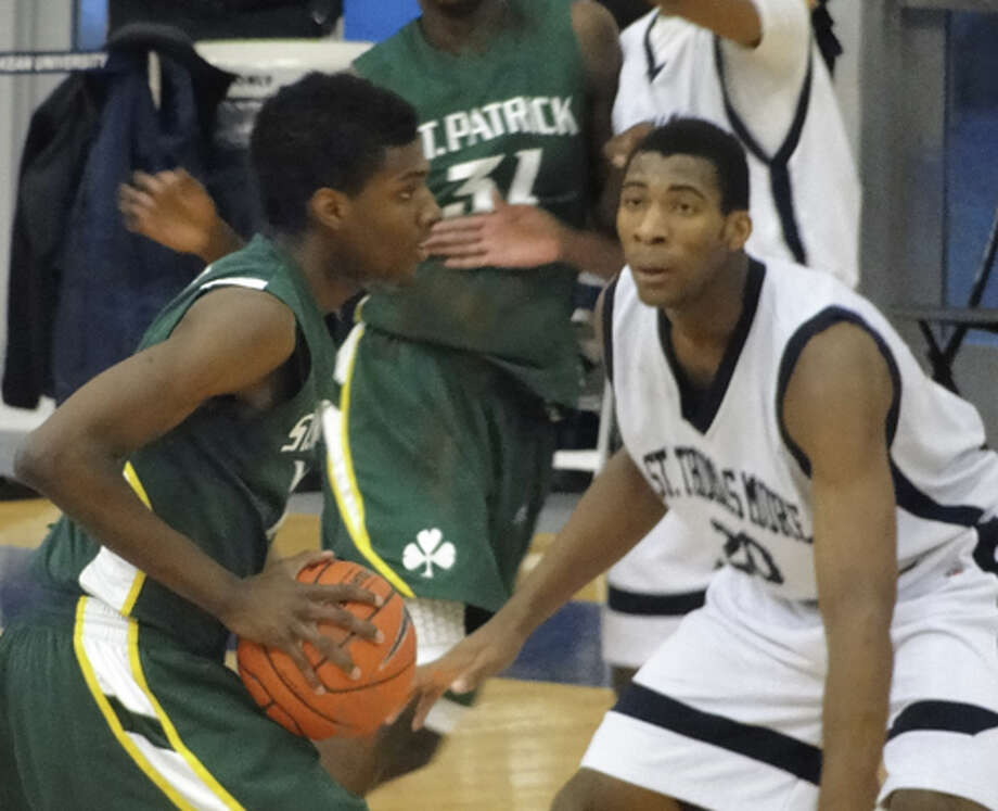 Andre Drummond (right) defends for St. Thomas More at the Primetime Shootout, February 13, 2011. Drummond, a highly sought 6-foot-7 center from Middletown, CT, announced he will attend Wilbraham & Monson prep school in Massachusetts on August 10, 2011.
