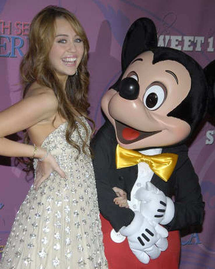 "Miley Cyrus said she got a new puppy for her birthday. When asked what else she was getting, she said ``My parents shut down Disneyland for me, so I'm good for a while."" Photo: DAN STEINBERG, AP"