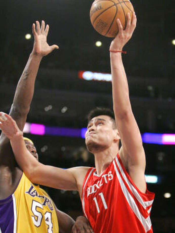 Yao Ming launches a shot over Kwame Brown. Photo: Mark J. Terrill, AP