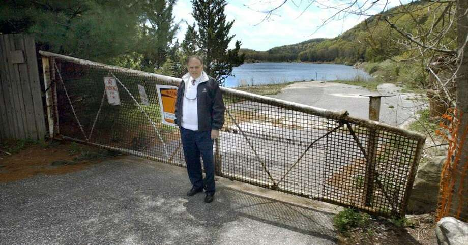 Pictured in this file photo is Robert Parker, President and CEO of Rock Acquisition LP, on a 107-acre quarry property in Brookfield that the state Department of Transportation took by eminent domain in 2004 for the Route 7 bypass project. A Danbury Superior Court judge ruled Wednesday that the state must pay Parker's company almost $20 million more than it originally did for the land. Photo: Carol Kaliff / The News-Times