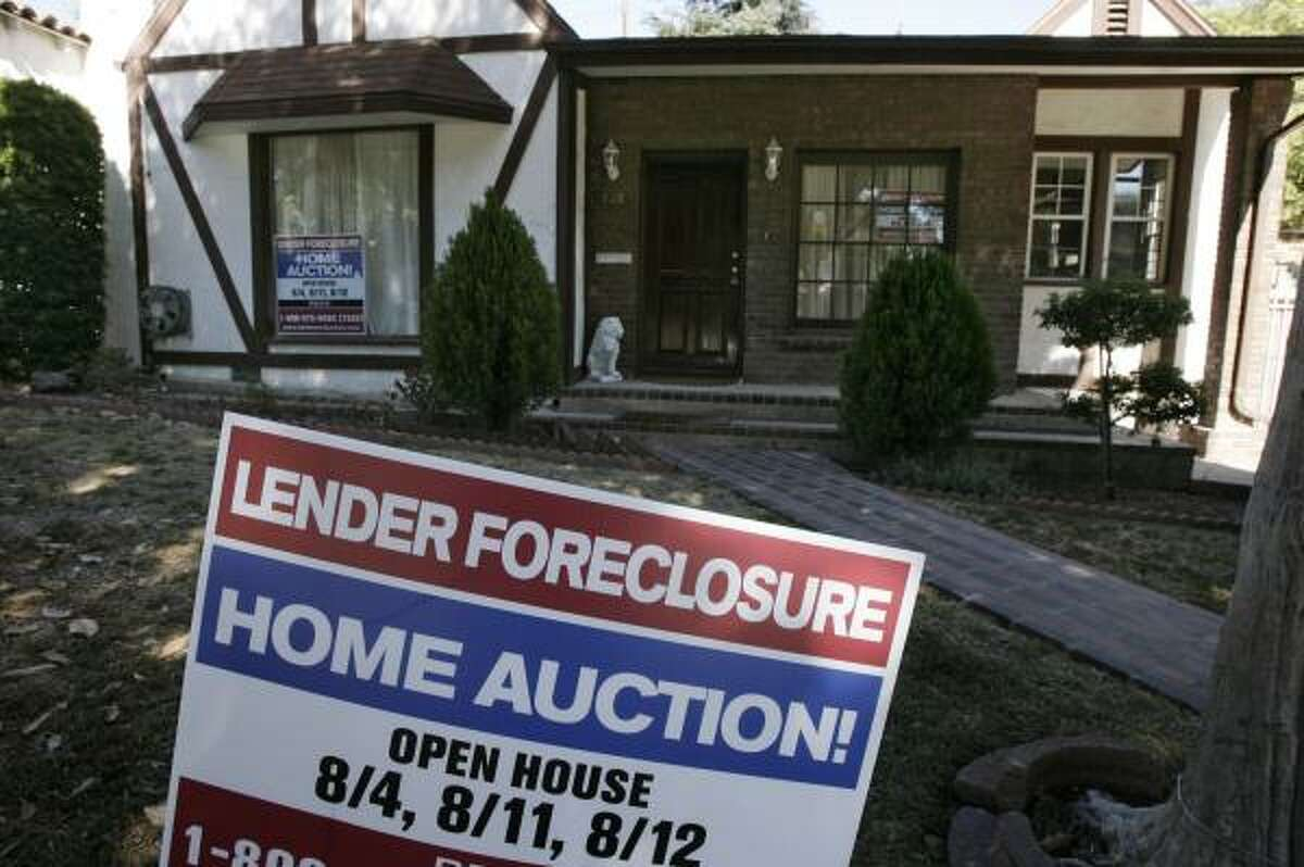 A foreclosed house awaits a new owner in Glendale, Calif. July foreclosure filings in the U.S. jumped 93 percent from July 2006.