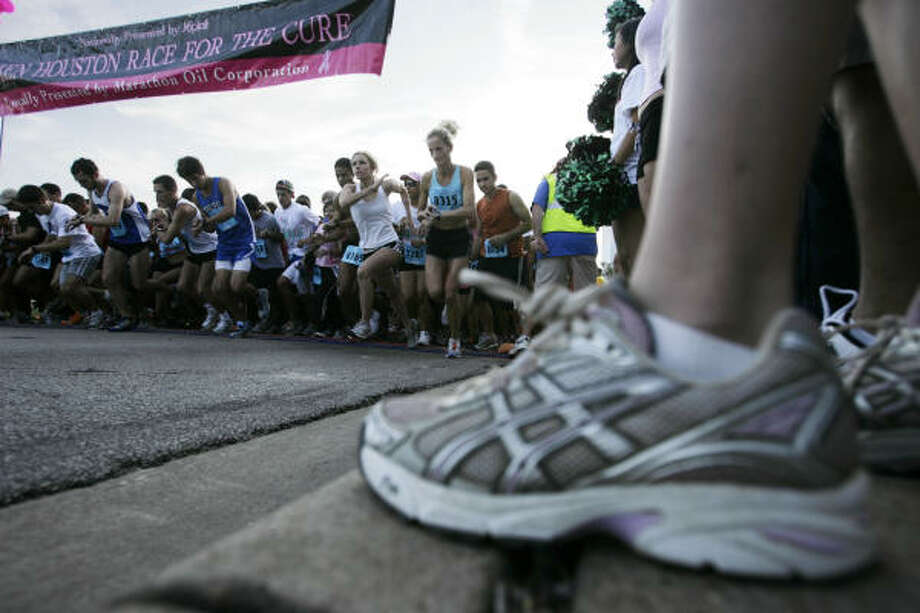 Competitive runners line up on Allen Parkway for the Susan G. Komen Houston Race for the Cure in Houston on Saturday. Photo: Eric Kayne, Chronicle