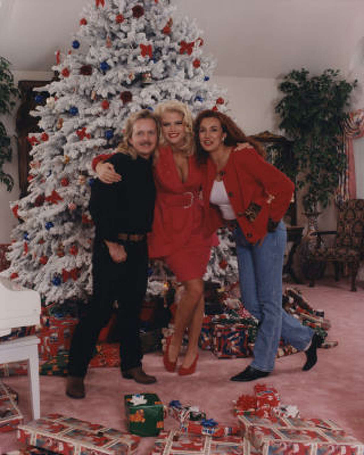 Photographer Eric Redding and his wife D'Eva's updated edition of Great Big Beautiful Doll, a biography story of their experiences with Anna Nicole Smith, center, hit newsstands the day after the model's death.