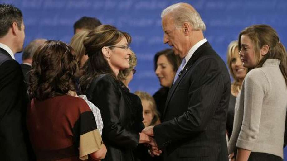 Republican Gov. Sarah Palin, left, and Democratic Sen. Joe Biden, D-Del., were joined on stage by their families after the verbal tussle at Washington University in St. Louis. Thursday night's debate was the first time the candidates met personally. Photo: J. SCOTT APPLEWHITE, ASSOCIATED PRESS