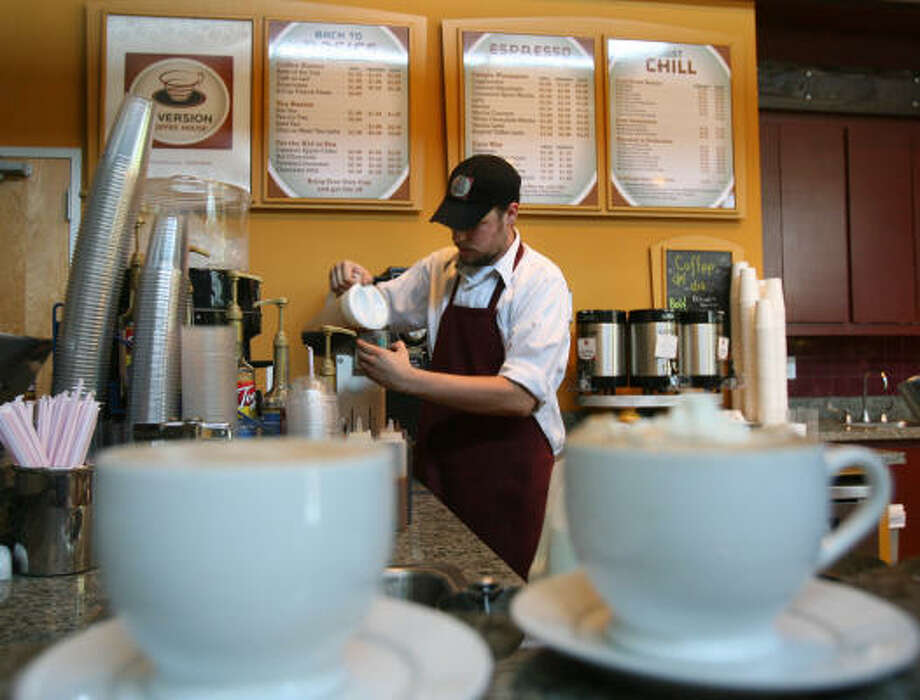 Dave Noske works behind the counter at  Inversion Coffee House on Montrose. Photo: Billy Smith II, The Houston Chronicle