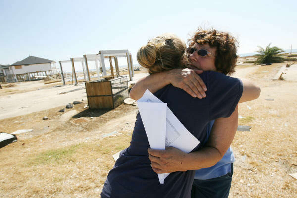 """""""You are back,"""" says Shirley Hamilton as she embraces Taylor Ponder, 17, a high school friends of her granddaughter who evacuated before Hurricane Ike. About 40-50 residents remain missing."""