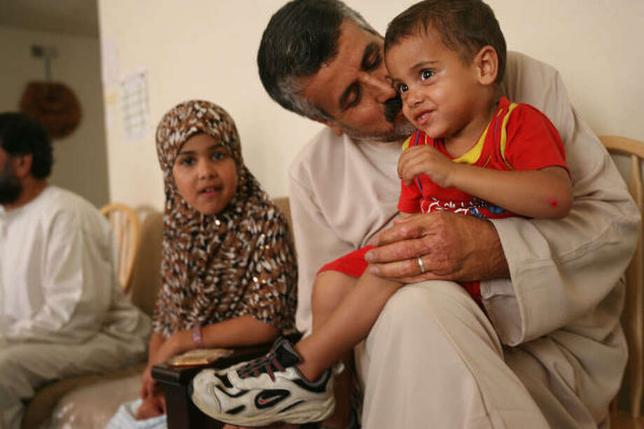 Hamed Meegel, 41, sits with his son Natheer Suied, 2, and daughter Safa, 10, as the family prepares to celebrate its first Eid al-fitr in America. For this Iraqi refugee family struggling to make ends meet in Houston, the end of Ramadan is overshadowed by fears of what the future may hold. Photo: Mayra Beltran, Houston Chronicle