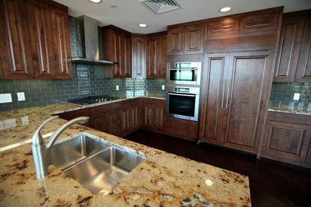 The kitchen of a condo at The Broadway luxury high-rise at 4242 Broadway Street is pictured July 26, 2011.  ANDREW BUCKLEY / abuckley@express-news.net Photo: ANDREW BUCKLEY, SAN ANTONIO EXPRESS-NEWS / Copyright: Andrew Buckley