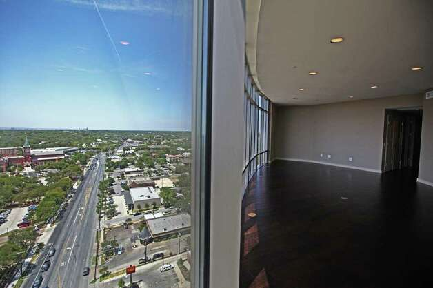 The view and living area of a condo at The Broadway luxury high-rise at 4242 Broadway Street is pictured July 26, 2011.  ANDREW BUCKLEY / abuckley@express-news.net Photo: ANDREW BUCKLEY, SAN ANTONIO EXPRESS-NEWS / Copyright: Andrew Buckley