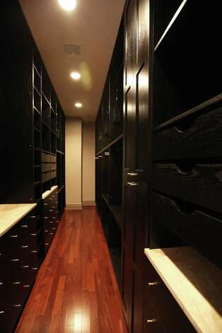 A closet in a condo at The Broadway luxury high-rise at 4242 Broadway Street is pictured July 26, 2011.  ANDREW BUCKLEY / abuckley@express-news.net Photo: ANDREW BUCKLEY, SAN ANTONIO EXPRESS-NEWS / Copyright: Andrew Buckley