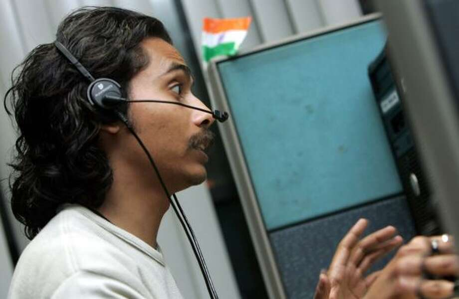 An employee of Convergys Corp., a global leader in call-center outsourcing, speaks with a client in Gurgaon, India. Photo: PHOTOS BY GURINDER OSAN, ASSOCIATED PRESS