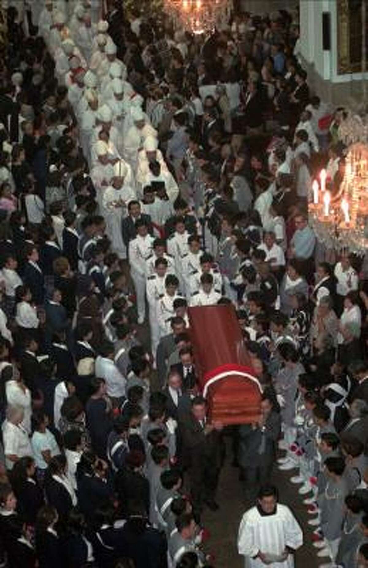 The coffin of the slain bishop is borne through Guatemala City's Metropolitan Cathedral April 29, 1998.
