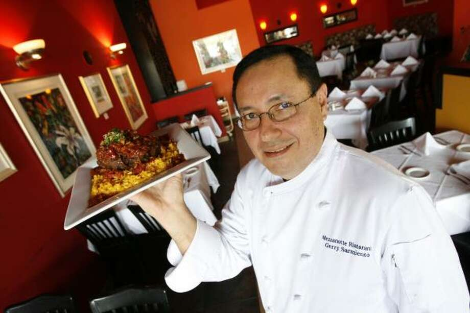 Gerry Sarmiento shows one of his specialties at his Italian restaurant, Mezzanotte, in Cypress. Photo: Billy Smith II, Chronicle