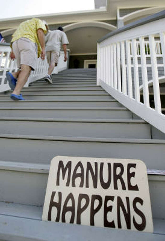 Don Anderson, top, and his neighbor, Steve Murray, climb the stairs to Anderson's home in Kemah Friday, as they begin the process of reclaiming their property after Hurricane Ike. Photo: Karen Warren, Chronicle