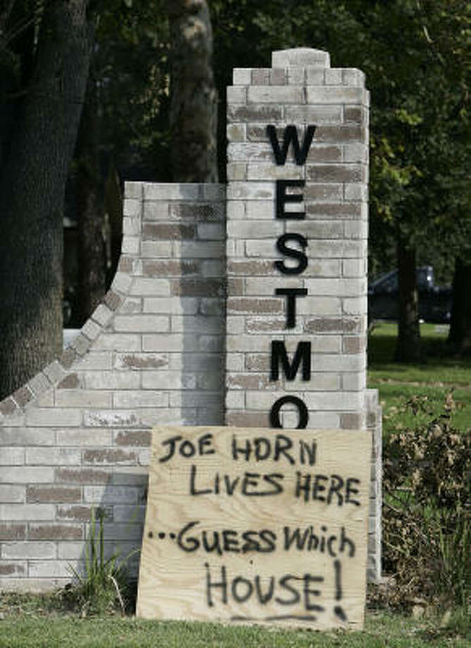 A bit of dark humor greets drivers passing through the Westmont subdivision in west Houston at Westerland and Richmond. Horn made headlines last year for killing two men breaking into his neighbor's house. Photo: Craig Hartley, For The Chronicle