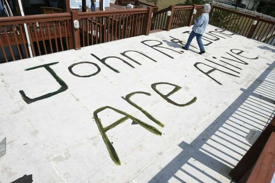 June Peveto hoped her children and friends would see the sign on media reports after Hurricane Ike. She and her husband John R. Peveto rode out the storm in their stilted house. Photo: Sharon Steinmann, AP