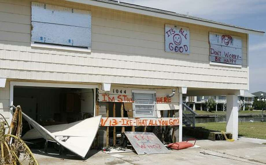 Optimistic signs decorate a house in Bayou Vista, Texas, in the aftermath of Hurricane Ike. Photo: Kevin M. Cox, AP