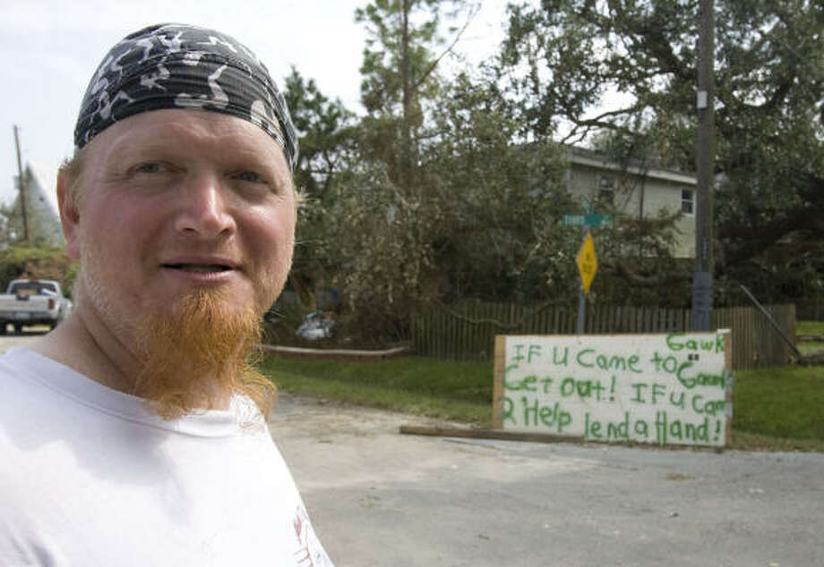 Mark Vermillion stands near a sign he made in front of his home in Seabrook. Photo: James Nielsen, Chronicle