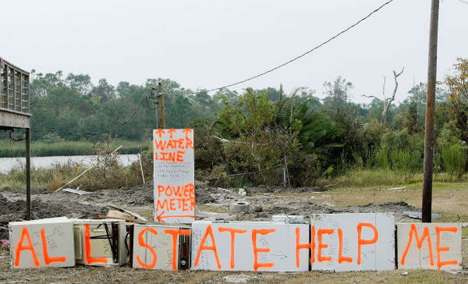 "A sign on the remains of a home damaged by Hurricane Ike reads ""Allstate Help Me"" in Seabrook, Texas. Photo: Mark Wilson, Getty Images"