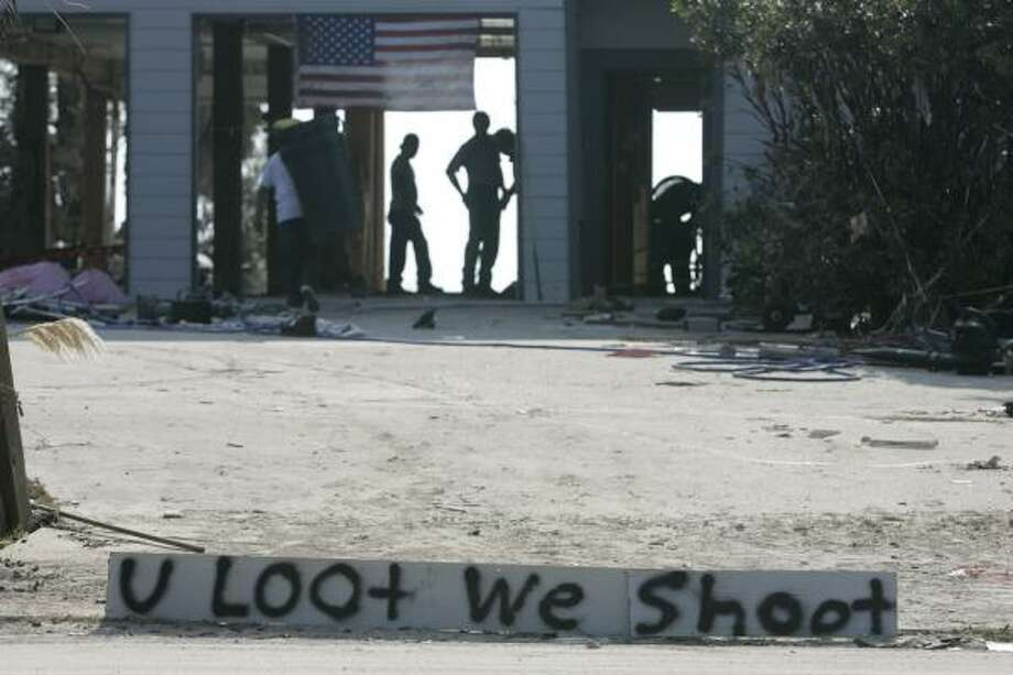 A sign warns of what may happen outside a beach-front home in Seabrook, Texas. Photo: Marcio Jose Sanchez, AP