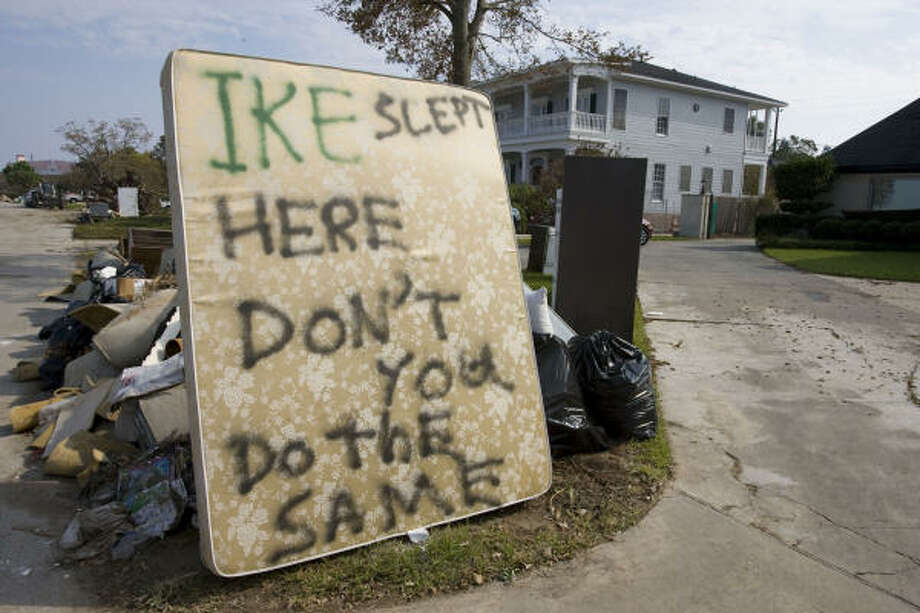 A message was painted on a matress in front of homes damaged by Hurricane Ike in Shoreacres. Photo: James Nielsen, Chronicle