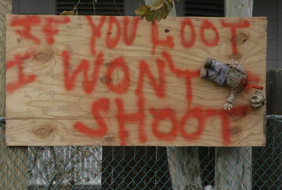 One resident went against the usual warning to looters and got a little more graphic in Galveston. Photo: Julio Cortez, Chronicle