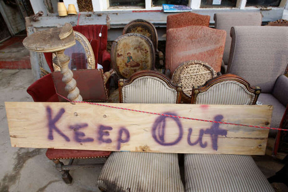 The owners of an antique shop on the Strand kept it simple in Galveston. Photo: Scott Olson, Getty Images