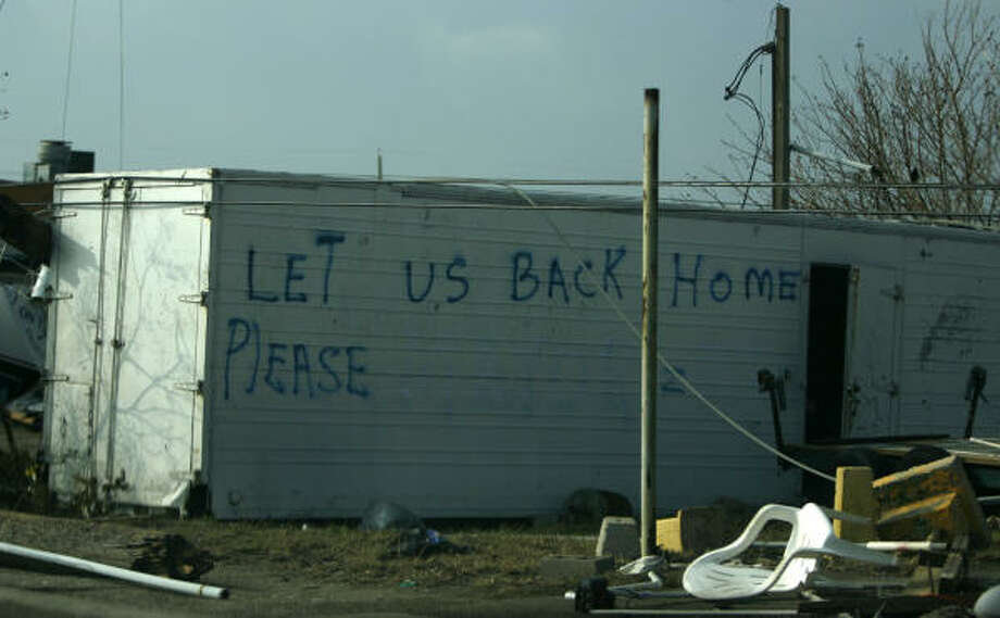 "A trailer in Galveston says ""Let Us Back Home Please."" Photo: Karen Warren, Chronicle"
