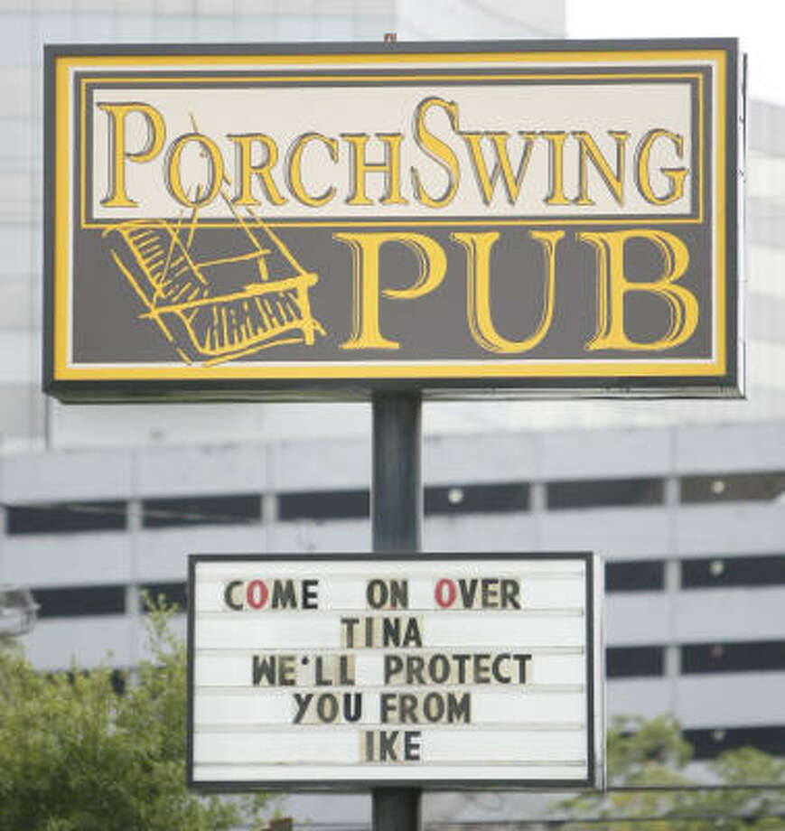 A sign at the PorchSwing Pub announced that it was open for business as Houston prepared for the arrival of Hurricane Ike. Photo: Karen Warren, Chronicle