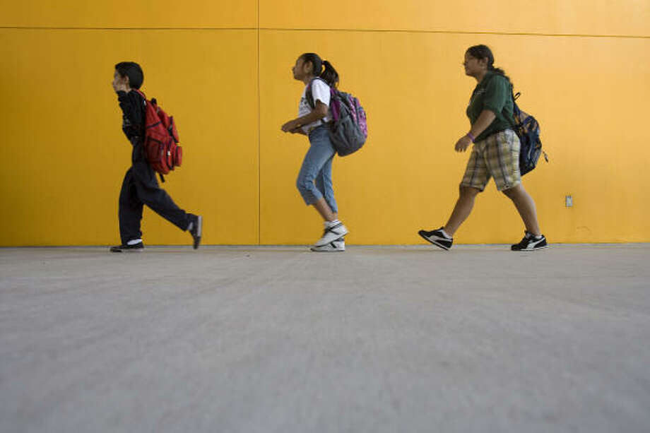 NEW START:KIPP 3D Academy's Alfonso Ortiz, 10, Ariana Martinez, 10, and Maria Carachure, 12, arrive at KIPP Houston southwest campus after Hurricane Ike Tuesday, Sept. 23. KIPP 3D Academy relocated students to the southwest campus due to lack of power. Photo: James Nielsen, Chronicle