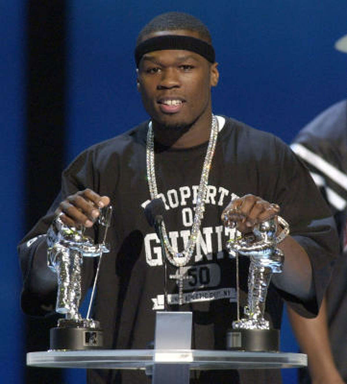Hip-hop artist 50 Cent accepts the Best Rap Video of the Year award for In Da Club at the MTV Video Awards in 2003. Watching the video on Yahoo moved Universal Music Group CEO Doug Morris to pull his company's videos from the Web portal until it agreed to a licensing agreement in 2005.