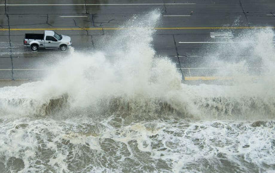 Waves crash over the seawall on Galveston Island as Hurricane Ike approached the Texas Gulf Coast,. Photo: Smiley N. Pool, Houston Chronicle