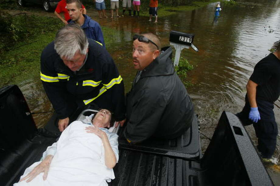 Peggy Eisworth,76, is placed in the bed of truck to be driven out of a flooded street and transfered to an ambulance on Colleen Street after Hurricane Ike passed through Pearland. Photo: Mayra Beltran, Houston Chronicle