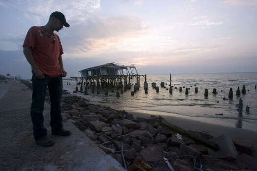 Ralph Crawford Jr., a former Houstonian now living in Conroe, was sent here to clean up the remnants of Hooters, Murdock's Pier and the Balinese Room after Hurricane Ike in Galveston. Photo: Johnny Hanson, Houston Chronicle