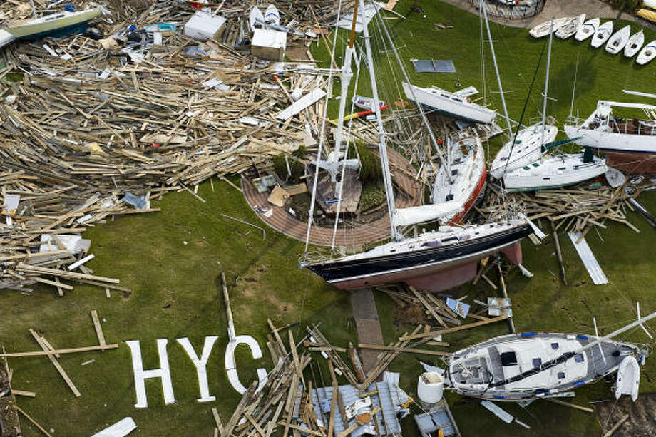 Sailboats and debris can be seen strewn about the Houston Yacht Cub after Hurricane Ike. Photo: Smiley N. Pool, Houston Chronicle