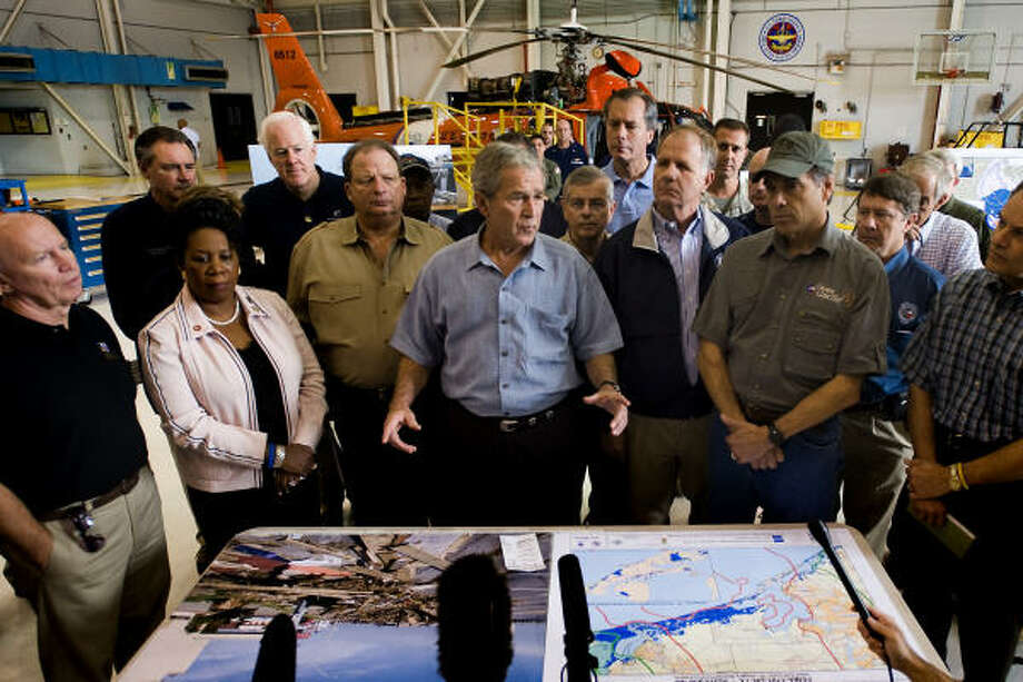 President George W. Bush addresses the media following a meeting with local officials at Ellington Field in Houston before a tour of areas damaged by Hurricane Ike. Photo: Smiley N. Pool, Houston Chronicle