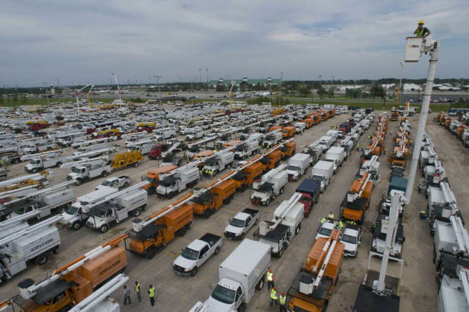Thousands of linemen and tree service workers arrive and are dispatched from Sam Houston Race Park in the effort to restore electrical power in the aftermath of Hurricane Ike. Photo: Steve Ueckert, Houston Chronicle