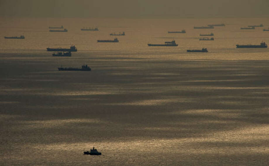 Ships wait off the shore at Galveston to enter the Houston Ship Channel following Hurricane Ike. Photo: Smiley N. Pool, Houston Chronicle