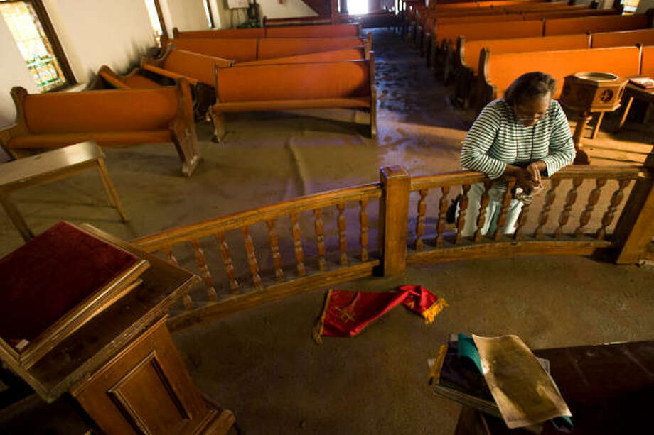 Salatheia Bryant-Honors, co-Pastor of Reedy Chapel A.M.E., prays after taking her first look at the historic church in Galveston. Photo: Nick De La Torre, HOUSTON CHRONICLE