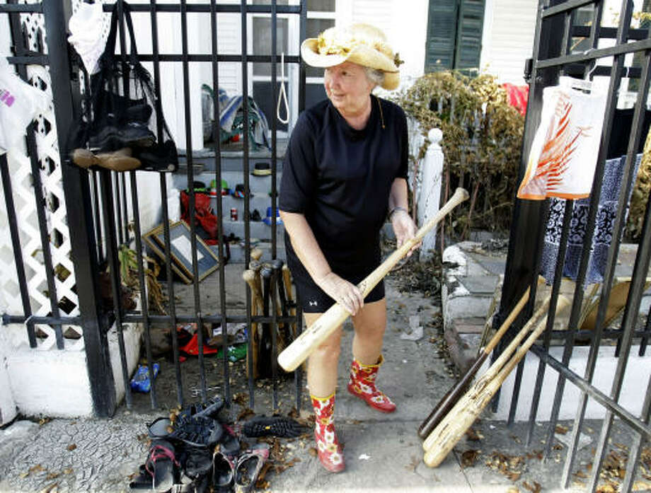 Judy Grace pulls bats out of her house after Hurricane Ike hit Galveston. Grace is an Astros fan, and works for the Astros in Kissimmee, Fla., during spring training. Photo: Karen Warren, Chronicle