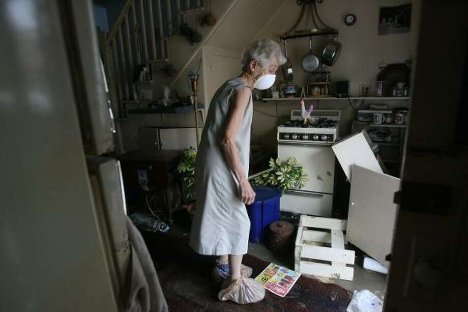 Margaret Dutton looks at her kitchen for the first time in 12 days, since Hurricane Ike came through, as residents who live behind the seawall in Galveston were allowed to return home. Photo: Mayra Beltran, AP