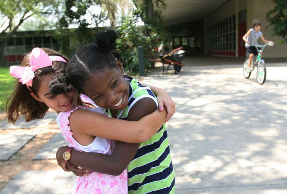 """""""Hanna, Hanna!"""" says Annakatia Batoum, 7, as she hugs classmate Hanna Fradkin, 8, in front of Kolter Elementary School since its the first time they see each other since school was suspended due to Hurricane Ike. Photo: Mayra Beltran, Houston Chronicle"""