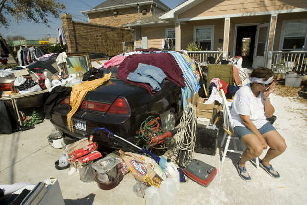 Ellen Smecca, of Galveston, wipes her eyes as she sits outside her flood damaged home with most of her belongings that were damaged in the aftermath of Hurricane Ike. Photo: Brett Coomer, Chronicle