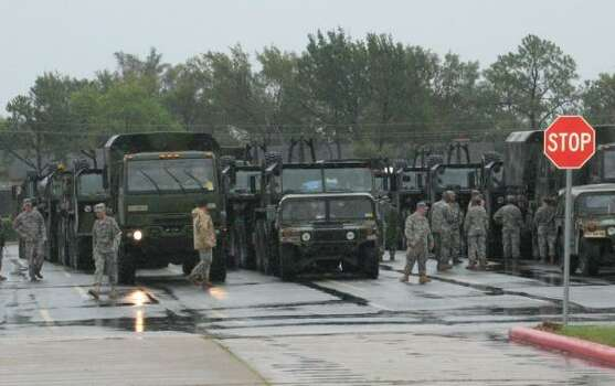 National Guard members scramble at a parking lot at Stratford High School on Dairy Ashford near Memorial. Photo: Laura Wiesman, Chronicle