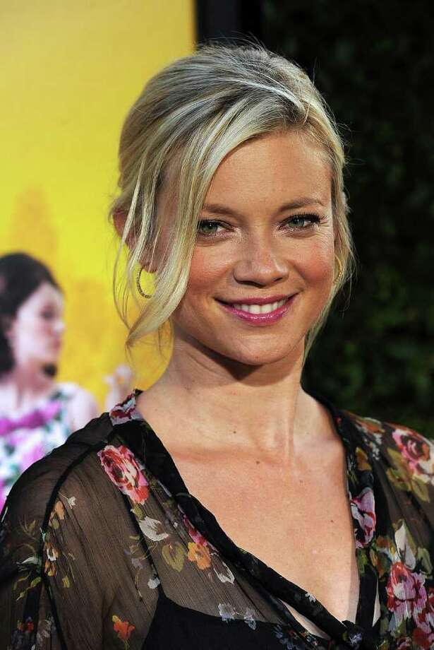 Actress Amy Smart attends the premiere Of DreamWorks Pictures' 'The Help' held at The Academy of MotiPicture Arts and Sciences, Samuel Goldwyn Theater in Beverly Hills, California. Photo: Frazer Harrison, Getty Images / 2011 Getty Images