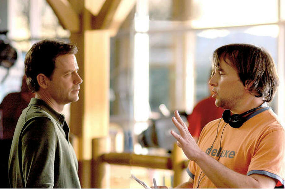 Director Richard Linklater, right, gives instructions to actor Greg Kinnear during the making of Fast Food Nation. Photo: Courtesy Photo