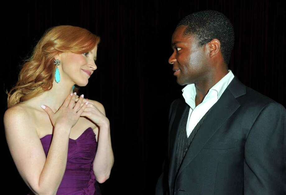 "Actors Jessica Chastain  (L) and David Oyelowo attend the premiere of DreamWorks Pictures' ""The Help"" held at The Academy of MotiPicture Arts and Sciences, Samuel Goldwyn Theater in Beverly Hills, California. Photo: Alberto E. Rodriguez, Getty Images / 2011 Getty Images"