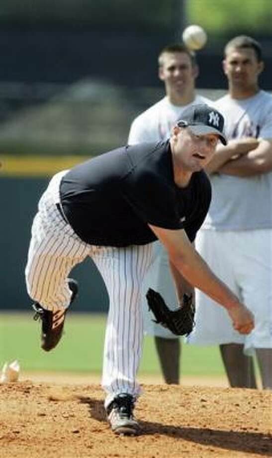 Roger Clemens (shown working out on Tuesday in Lexington, Ky.) opted against a career-closing season with the Astros. Photo: James Crisp, AP